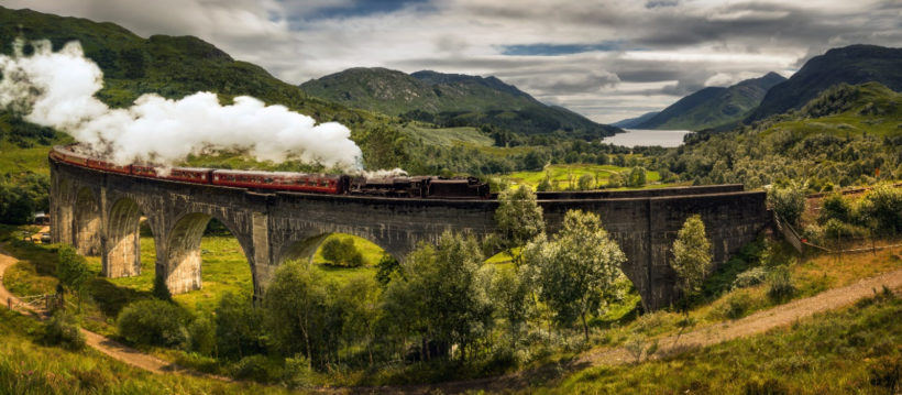 Enchanting-Travels-UK-Ireland-Tours-Panorama-of-Jacobite-steam-train-on-old-bridge-Scotland